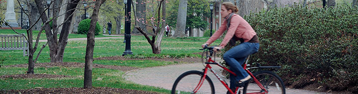 A cyclist riding around UNC campus