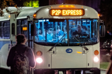 Picture of P2P bus picking up riders after dark